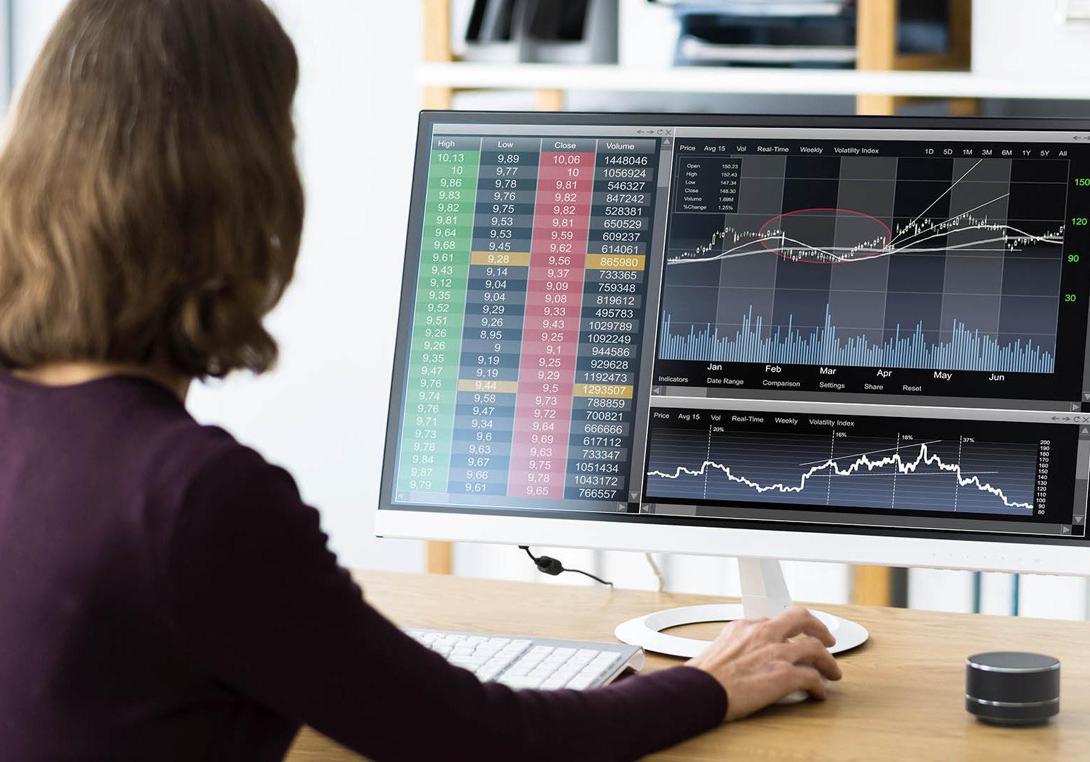 Financial Broker Or Trader Woman At Office Desk